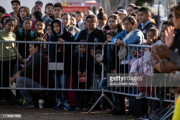 Asylum seekers gather as they look for an appointment date with US authorities outside El Chaparral crossing port on the USMexico border in Tijuana...