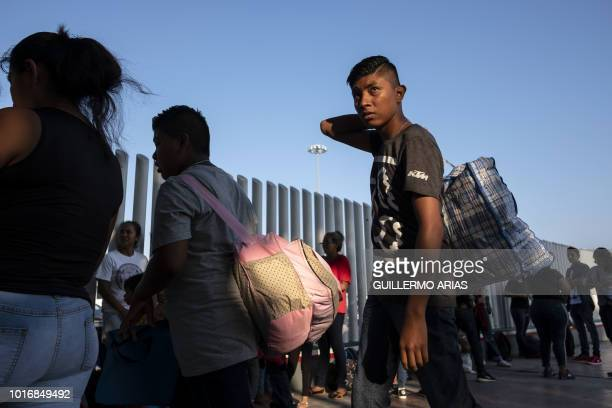 Asylum seekers gather at El Chaparral port of entry in Tijuana Baja California state Mexico on August 10 as they look for an appointment to present...
