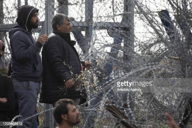 Asylum Seekers, mostly women, waiting at Turkey's Pazarkule border crossing to reach Europe, stage a demonstration at the buffer zone demanding to...