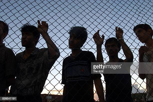 Asylum seekers on their first day in the compound at Nauru after their long voyages on the Tampa Aceng and Manoora 19 September 2001 The AGE Picture...