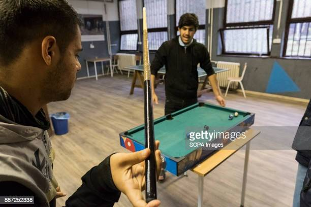 CAMP OBRENOVAC BELGRADE SERBIA Asylum seekers play a game of pool in a social room provided in a Serbian refugee camp With Hungary and Croatia...