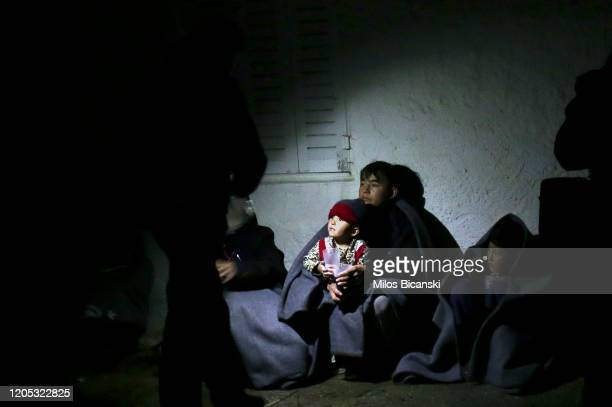 Asylum seekers recover after crossing the Aegean sea from Turkey to the Greek island of Lesvos on a dinghy on March 5, 2020 in Mitilini, Greece....