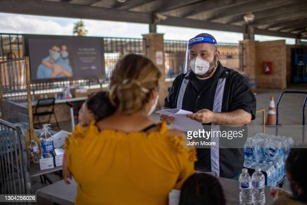 Asylum seekers register for rapid Covid-19 tests in an isolation area at a bus station on February 26, 2021 in Brownsville, Texas. U.S. Immigration...