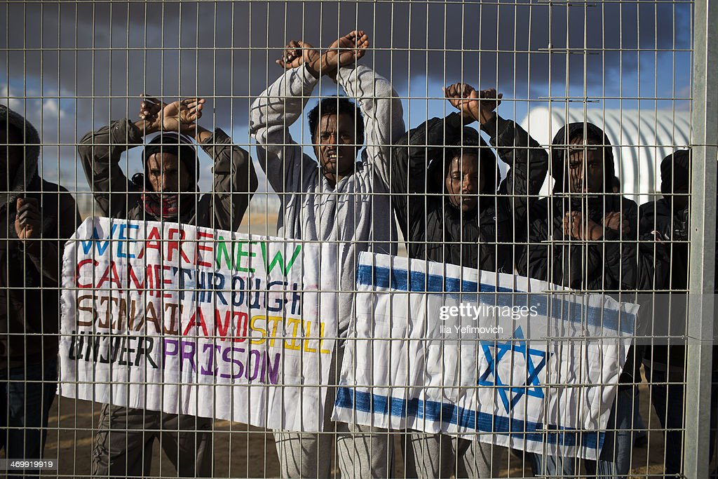 Asylum seekers who are being held take part in a day of protest at the of Holot detention center where hundreds of migrants are being held on February 17, 2014 in the southern Negev desert of Israel. More than 50,000 illegal African migrants are seeking asylum after escaping war and government repression in their native lands.