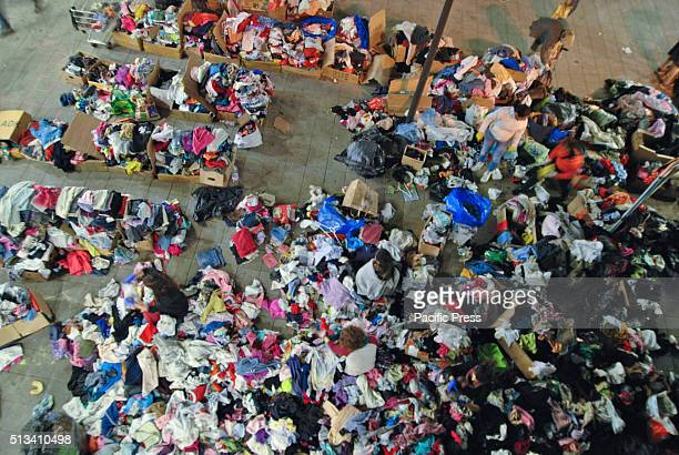 Asylumseekers at Keleti train station in Budspest select clothing that will fit them from various donors They are believing that they can go to...