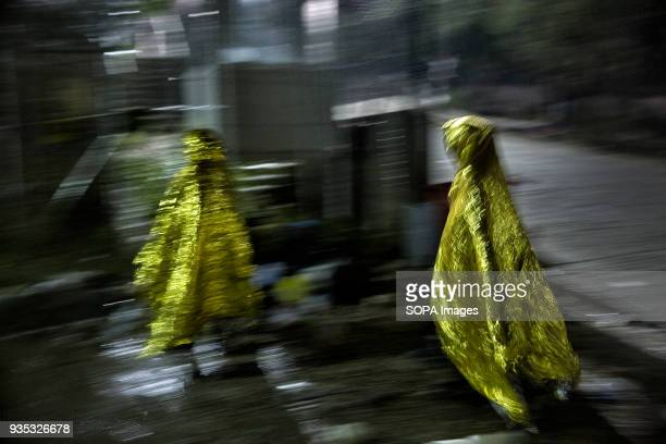 Asylumseekers covered only in metallic warming blankets try to keep warm under a relentless cold rain after arriving in Greece In 2015 more than a...