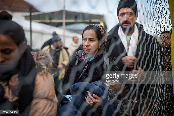 SPIELFELD AUSTRIA Asylumseekers from Syria and Iraq waiting to cross the border into Austria from Slovenia on February 20 2016 Austria implemented...
