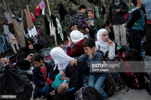 Asylumseekers gather at a collection point where they can rest before waiting for buses to take them to a camp where they are required to register...