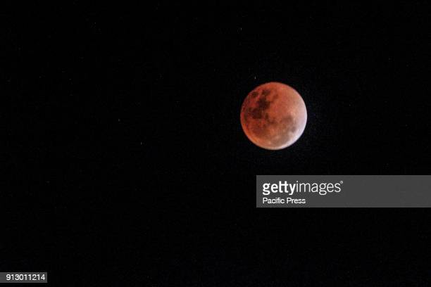 At 01001 PM Philippine time The moon finally passes by beginning to once again reflect light from the sun extinguishing the reddish hue from the