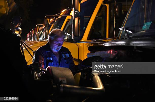 At 5:30a.m. Paul Cochran goes over his checklist under the hood of his bus. He does a thorough walk around and check of his bus before each run....