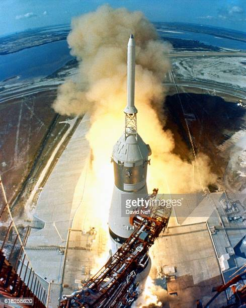 32 am EDT the swing arms move away and a plume of flame signals the liftoff of the Apollo 11 Saturn V space vehicle and astronauts Neil A Armstrong...