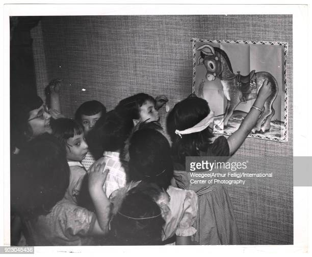 At a birthday party a group of children play pinthetaleonthedonkey 1940s Photo by Weegee /International Center of Photography/Getty Images