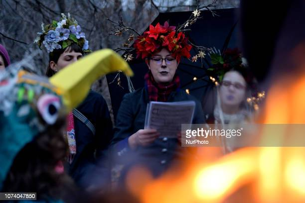At a bonfire a choir sings traditional slavic songs as hundreds participate in the eight annual Parade of Spirits Krampus Parade through the Northern...