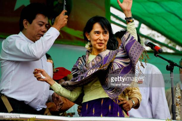 At a campaign rally for Aung San Suu Kyi near Mandalay in March 2012 ON the stage for the NLD National Ligue for Democracy Suu Kyi wave to the crowd