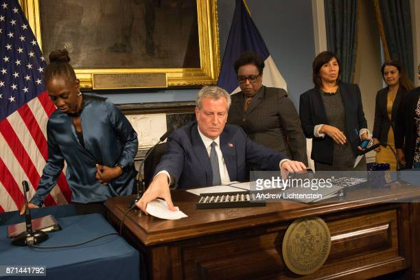 At a ceremony at City Hall New York City mayor Bill De Blasio signs legislation creating 'safe leave' for city victims of sexual and domestic...