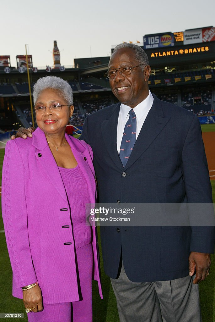 At a ceremony commemorating the 30th anniversary of his record setting 715th homerun, Hank Aaron and his wife Billye Aaron pose for a picture, before the Atlanta Braves challenged the New York Mets at Turner Field on April 8, 2004 in Atlanta, Georgia. The Braves won 10-8.