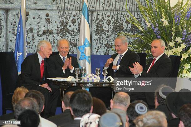 At a ceremony to renominate Professor Stanley Fischer to a second term as Governor of the Bank of Israel Fischer smiles as from left Israel President...