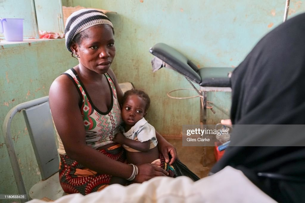 At a children's hospital in northern Burkina Faso, a female doctor treats children at a remote rural clinic. : News Photo