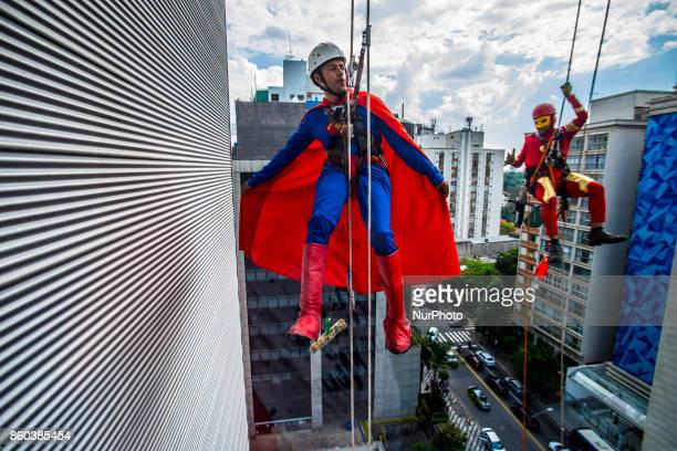 At a childrens hospital in Sao Paulo two window washers dressed up as Superman and fellow superhero lit up the faces of young patients A day of...