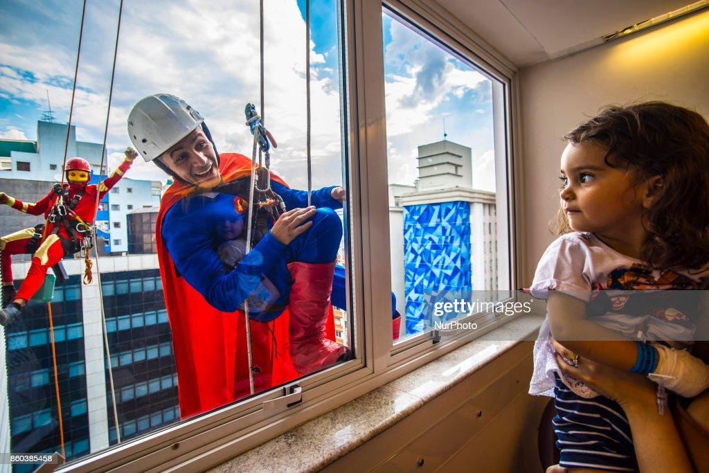 Superhero window washers make at Brazil hospital : News Photo