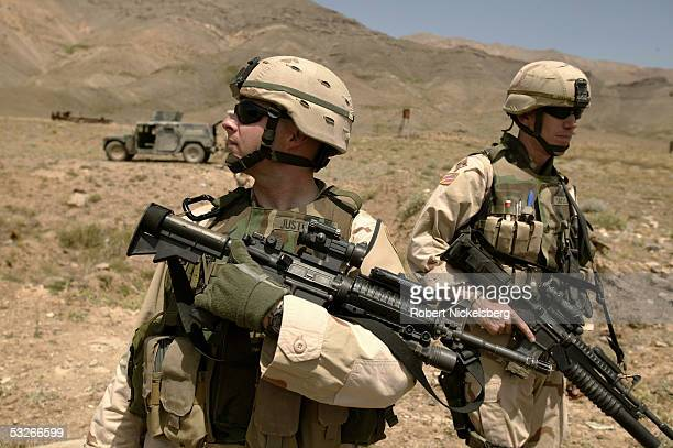 At a former Soviet military base 45 kms north of Kabul US Army Military Policemen provide security for a US Air Force Explosive Ordnance Disposal...
