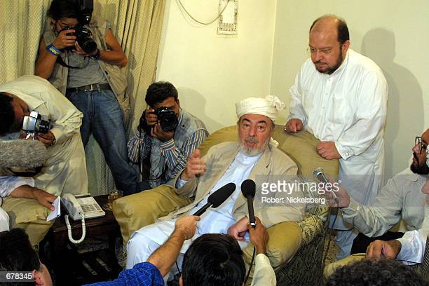 At a gathering of Afghan clan elders October 7 2001 in Peshawar Pakistan Pir Sayeed Ahmed Gailani addresses the press Gailani is a former Afghan...