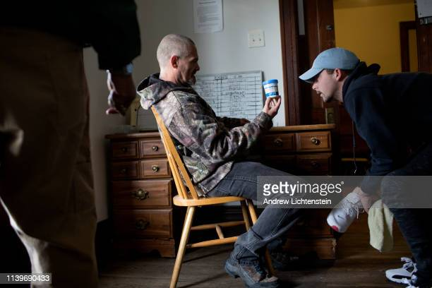 At a half way house for recovering addicts supervisors who are in recovery themselves use a fentanyl strip to test for drugs in the urine of a fellow...
