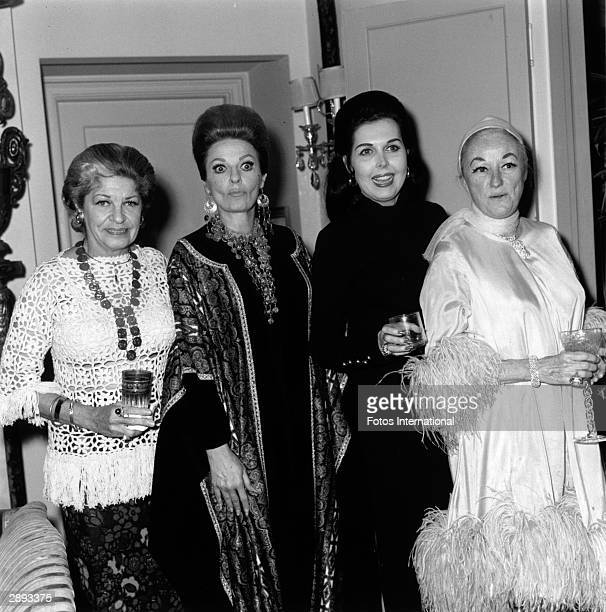 At a 'Hello Dolly' party American actors Martha Raye Carole Cook Ann Miller and Phyllis Diller pose together Los Angeles California March 1971 All...