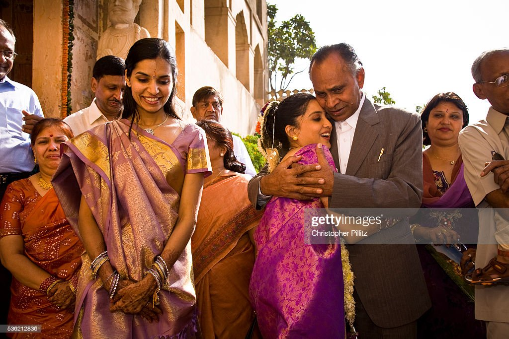 at a hindu wedding ceremony the just married bride bids her