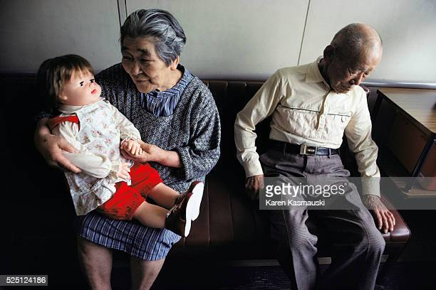 At a home for survivors of the ABomb in Hiroshima old women often keep a life size baby doll as a companion Most women who keep these dolls think...
