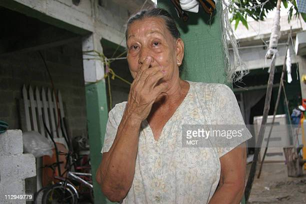 At a home she shares with 25 relatives in Tampico Mexico Olivia Smith mourns the loss of her son and grandson who died working on a Massachusetts...