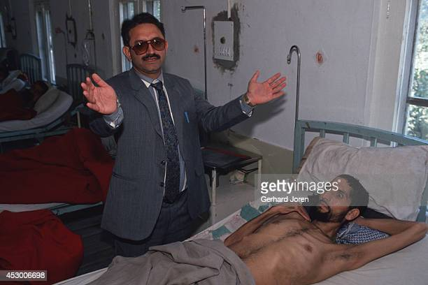 At a hospital in Muzaffrabad in Azad Kashmir Doctor Bashir Ur Rehman with his patient Abdul Hamid a 35 year old refugee He was paralysed after being...