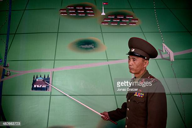 At a military garrison in North Korea a DMZ soldier displays a map of the area 60 years after the Korean War it is clear that not much has changed in...