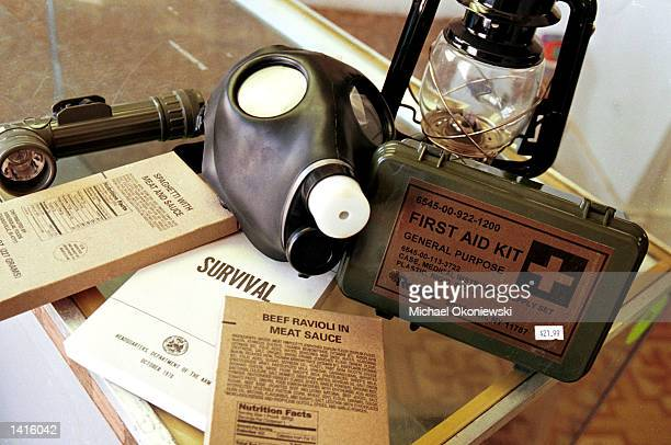 At a near empty Survival Preparedness Center the last of the products include a gas mask lantern military flashlight first aid kit field survival...