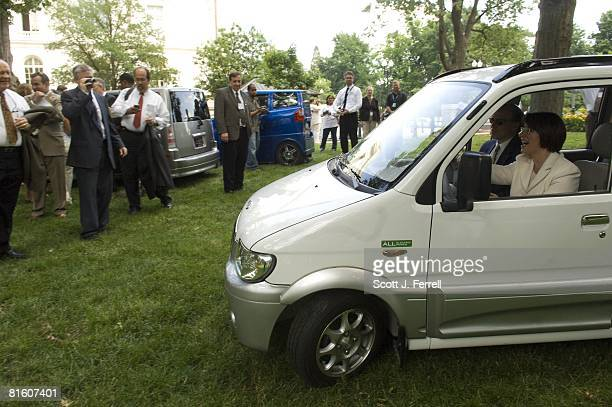 At a news conference on oil dependence and global warming Sen Amy Klobuchar DMinn takes a Miles ZX405 an allelectric vehicle produced by Miles...