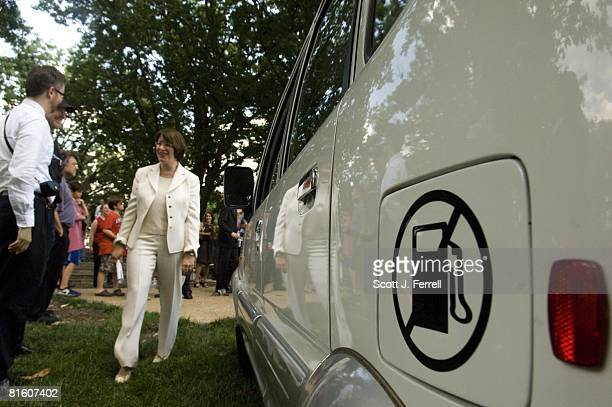 At a news conference on oil dependence and global warming Sen Amy Klobuchar DMinn checks out a Miles ZX405 an allelectric vehicle produced by Miles...