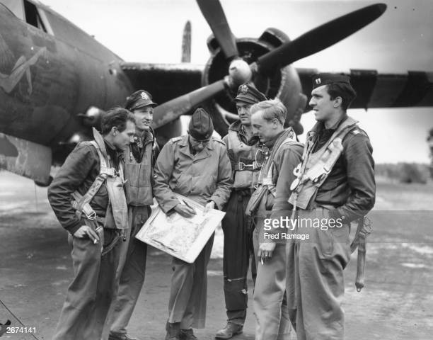 At a Ninth Air Force bomber base the crew of a Marauder B26 bomber report on what they have seen after attacking French beaches in preparation for...