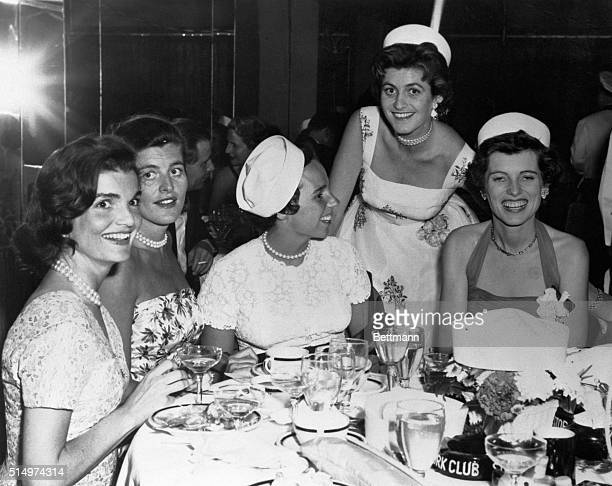 At a party being held in honor of Jean Kennedy sister of Democratic Senator John Kennedy Left to right seated Jacqueline Kennedy Patricia Lawford...