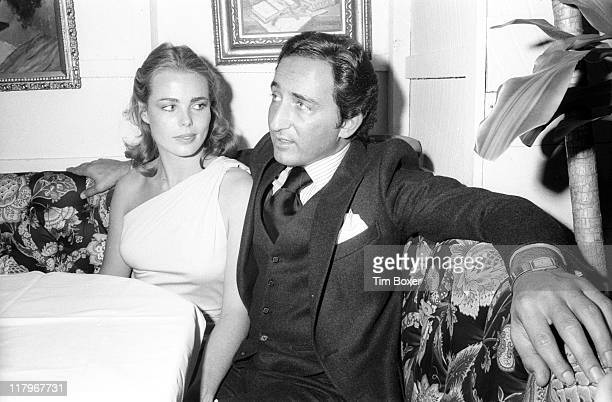 At a party for Faberge's 'Babe' perfume American actress and model Margaux Hemingway and her husband Errol Wetson sit at a table at Cecil's New York...