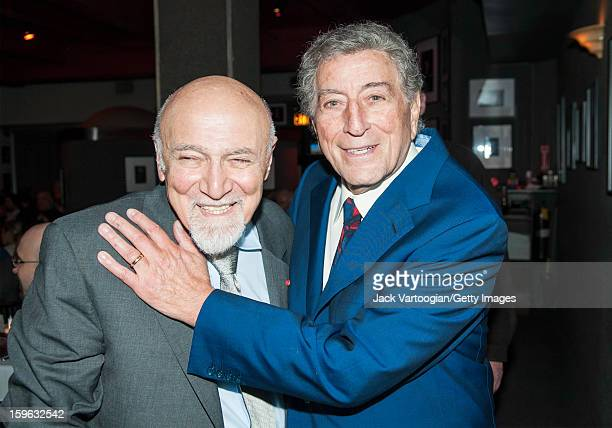 At a party in celebration of his 90th birthday American record producer George Avakian poses with singer Tony Bennett at the Birdland nightclub New...