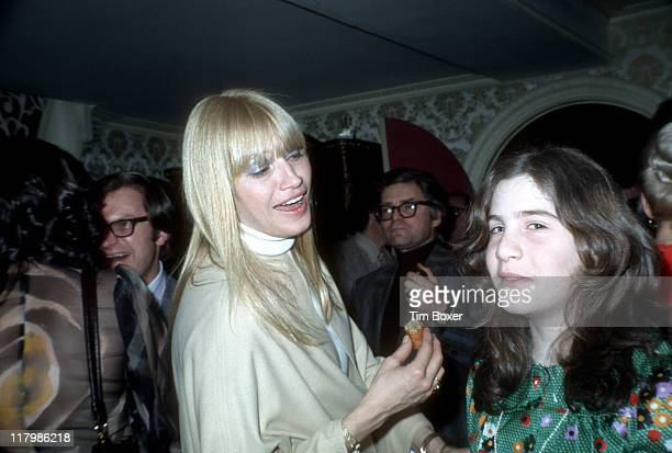 At a party in honor of her Carnegie Hall perfomance American singer Mary Travers smiles at her daughter New York New York February 1973 The party was...