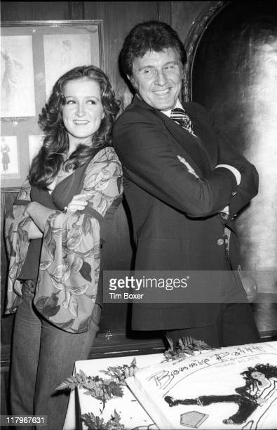 At a party to jointly celebrate her 26th birthday and the release of her fifth album American musician and singer Bonnie Raitt poses with her father...
