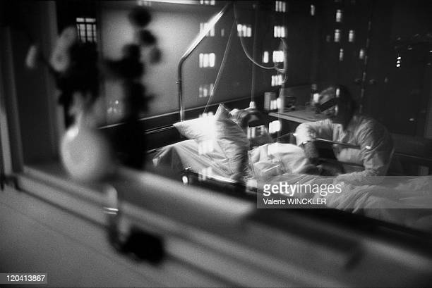 At a patient's bedside in Paris France A man at his wife's bedside at the palliative care unit at the International Hospital of the University of...