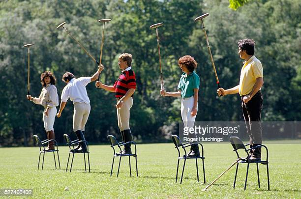 At a polo school near Suningdale on the outskirts of London a group of pupils are taught the basics of how to play poloInstaed of ponies they stand...