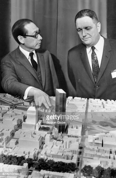 At a press conference in Boston on Nov 27 Architect IM Pei left and John Hancock Mutual Life Insurance Co President Robert E Slater present a model...