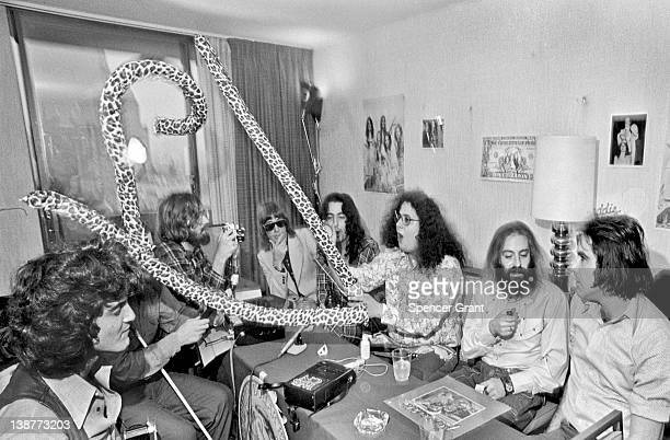 At a press conference musician Mark Volman from the group Flo Eddie opens a joke 'canned' snake Boston Massachusetts 1973 Volman and his bandmate...