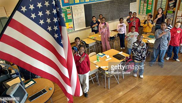 At a public school in Boston the Charles H Taylor elementary school children in the 4th grade class of teacher Maria Kubik say the morning pledge at...