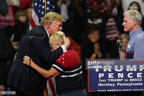 At a rally Donald Trump hugs a supporter a rally on November 4, 2016 in Hershey, Pennsylvania. The supporter is the mother of a child who son was a...