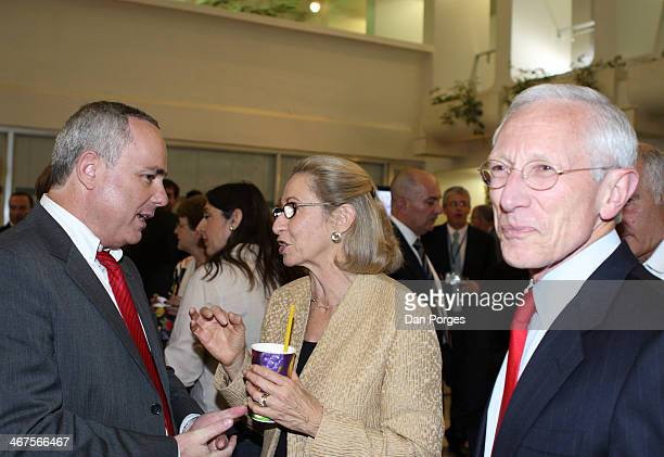 At a reception in the Bank of Israel building Governor of the Bank of Israel Professor Stanley Fischer stands by as his wife Rhoda Fischer speaks...