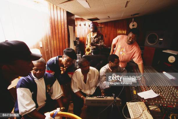 At a recording session in Dakar African musicians prepare to work together Seated are Papa Wemba Lourdes VanDunem looks over his shoulder An...